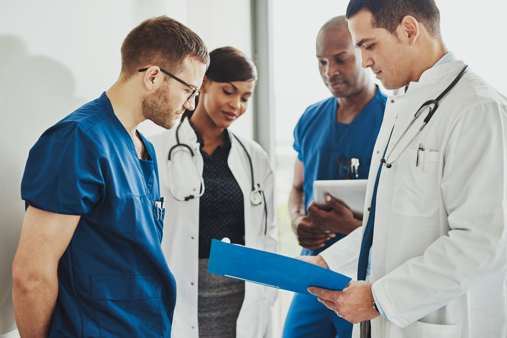 group-of-doctors-reading-a-document-PTWUG3K.jpg